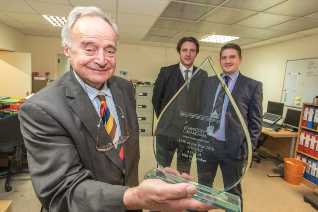 Beaming – AES Solar picks up the SME of the Year title at the Moray Chamber of Commerce Annual Awards. Pictured left to right are Managing Director George Goudsmit, Technical Director Campbell Maclennan and Commercial Director Jamie Di Sotto.