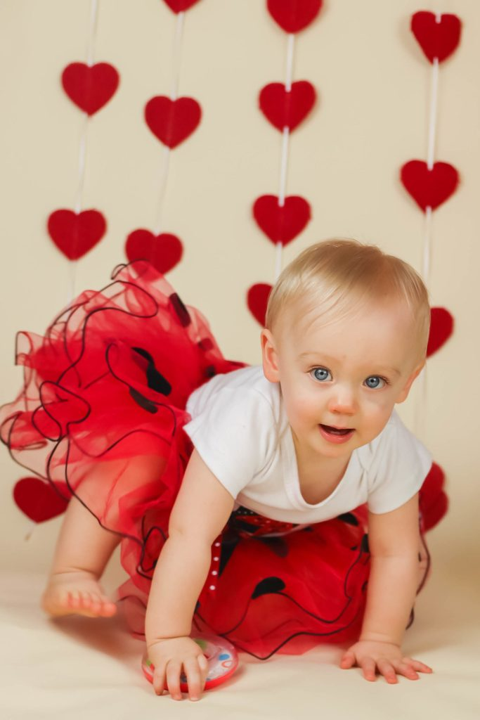 Love Themed 1st Birthday Photo with Heart background