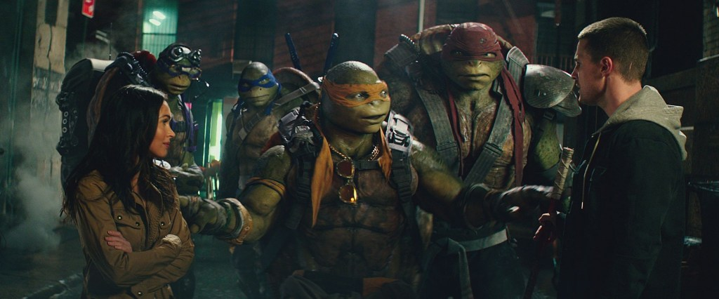 Left to right: Megan Fox as April O'Neil, Donatello, Leonardo, Michelangelo, Raphael and Stephen Amell as Casey Jones in Teenage Mutant Ninja Turtles: Out of the Shadows from Paramount Pictures, Nickelodeon Movies and Platinum Dunes