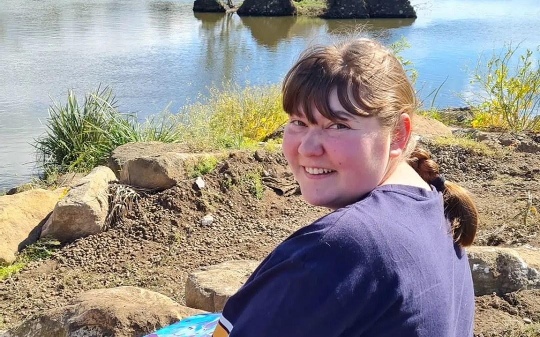 Kathryn sitting by Cherrywood Pond