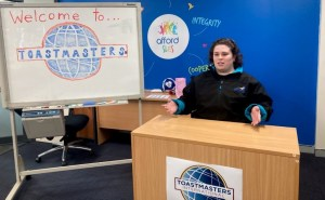 One of our SLES trainees giving a speech at the toastmasters event