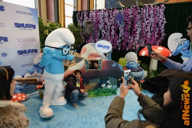 NEW YORK, NY - MARCH 18: Kids pose with Smurfs at the United Nations Headquarters celebrating International Day of Happiness in conjunction with SMURFS: THE LOST VILLAGE on March 18, 2017 in New York City. (Photo by Andrew Toth/Getty Images for Sony Pictures)