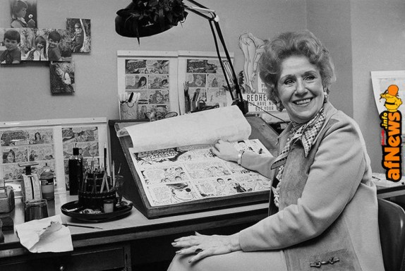 """Dale Messick, creator of the comic strip """"Brenda Starr,"""" looks up from some of her strips in her studio in her Chicago apartment in 1975. (AP) Read more: https://www.smithsonianmag.com/history/how-women-broke-into-male-dominated-world-cartoons-illustrations-180967803/#Clll7Pe1XhCT2XJc.99 Give the gift of Smithsonian magazine for only $12! http://bit.ly/1cGUiGv Follow us: @SmithsonianMag on Twitter"""