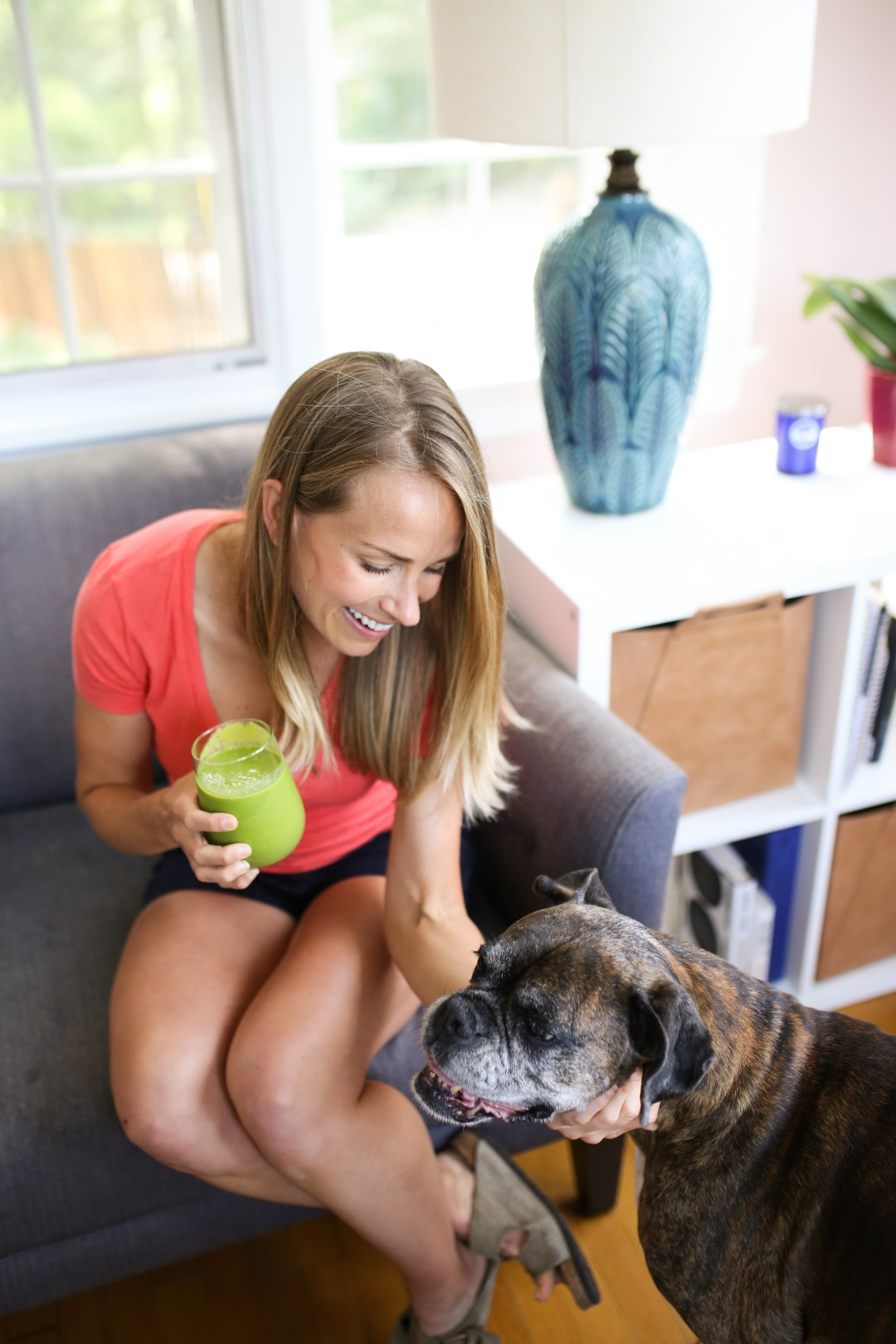 teri and dog, holding green smoothie