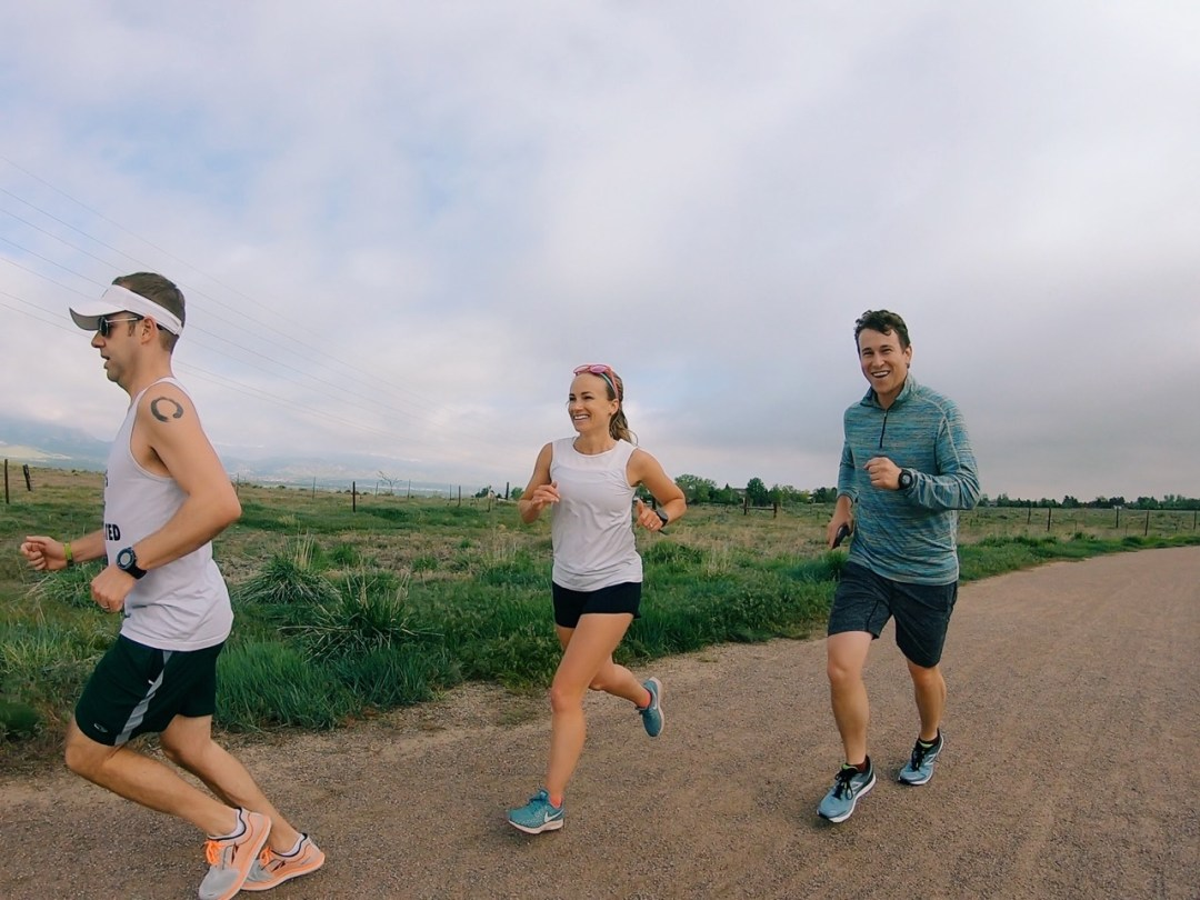 three people on a boulder colorado running trail