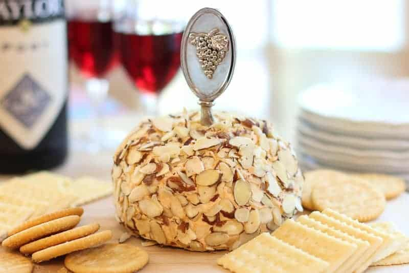 This swanky retro Port Wine Cheese Ball recipe was featured in City View Magazine.It has a sneaky heat balanced with the sweet port wine.Spread the cheese on crackers or apple slices for a fun party appetizer.