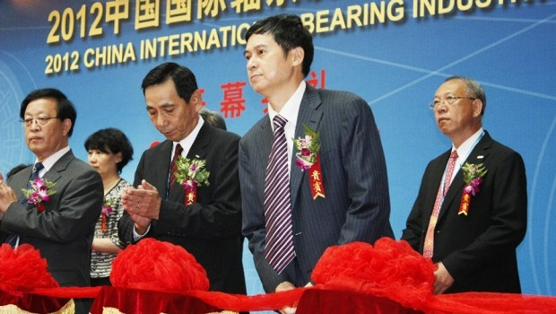 Ma Xingfa, third from left, Chairman, pictured in 2012, first saw opportunities in Australia after his son began studying engineering in Melbourne.