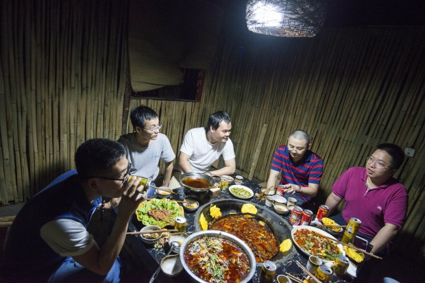 BitCoin operators enjoy a dinner of hot pot and Sichaun dishes not far from the warehouse which mines Bitcoin 24/7.