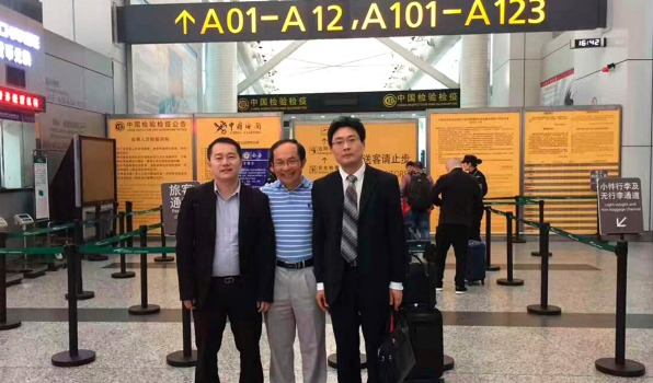 UTS academic Professor Feng Chongyi at the Guangzhou Airport on Saturday afternoon with his lawyers Chen Jingxue (at ...