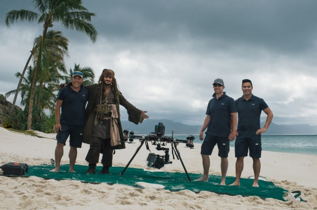 Stephen Oh, left, Johnny Depp as captain Jack Sparrow, and XM2 pilots in the Whitsundays during filming for Pirates of ...