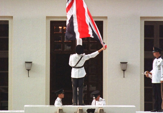 The British Union Jack flag is lowered at Government House on June 30, 1997,  for the last time.