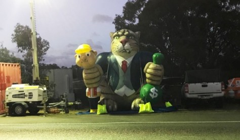 Unions brought out Greedy the Fat Cat at a picket at Esso's Longford gas plant to mark its first Australian appearance.