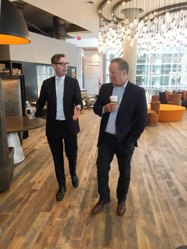 NSW Treasurer Dominic Perrottet and Greystone CEO Bob Faith at the company's Washington DC Anthology apartment complex ...