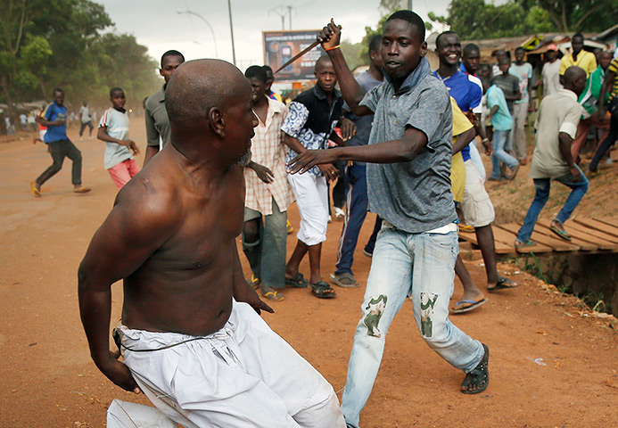 A Christian man chases a suspected Seleka officer in civilian clothes with