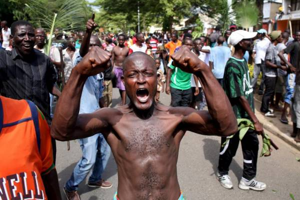 A man gestures as he celebrates in Bujumbura, Burundi