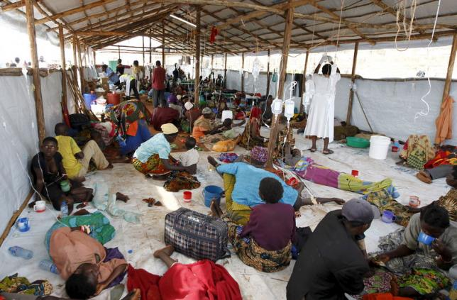 A general view shows Burundian refugees receiving treatment at a makeshift clinic at the Lake Tanganyika stadium in Kigoma western Tanzania