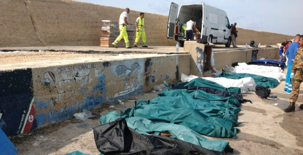Bodies of drowned migrants are lined up in the port of Lampedusa Thursday, Oct. 3, 2013. Tens of people died when a ship carrying African migrants toward Italy caught fire and sank off the Sicilian island of Lampedusa, spilling hundreds of passengers into the sea, officials said Thursday. Many migrants have been rescued, but the boat is believed to have been carrying as many as 500 people. It is one of the deadliest migrant shipwrecks in recent times and the second one this week off Italy: On Monday, 13 men drowned while trying to reach southern Sicily when their ship ran aground just a few meters (yards) from shore at Scicli. (AP Photo/Nino Randazzo, Health Care Service, HO)