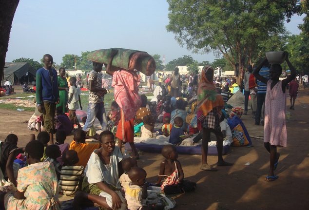 At least 3000 displaced women, men and children gather to seek shelter in Juba, South Sudan at the UN compound in Tomping area, Monday, July 11, 2016. Heavy explosions are shaking South Sudan's capital Juba Monday morning as clashes between government and opposition forces entered their fifth day, witnesses say, pushing the country back toward civil war. (Beatrice Mategwa/UNMISS via AP)