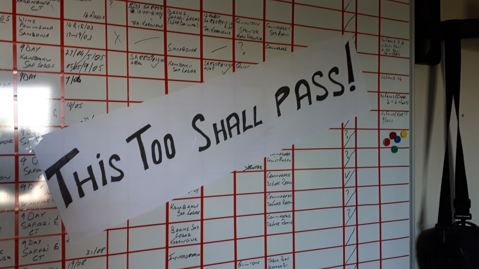 THIS TOO SHALL PASS emblazoned across the static Bookings Board reflecting the failed bookings from April to August