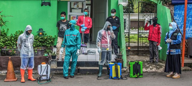 Volunteers prepare to disinfect public areas in Jakarta, Indonesia, in order to prevent the spread of COVID-19. (file)