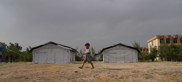A child walks through a temporary camp set up in Kabul after his family was displaced UNICEF due to insecurity across Afghanistan.
