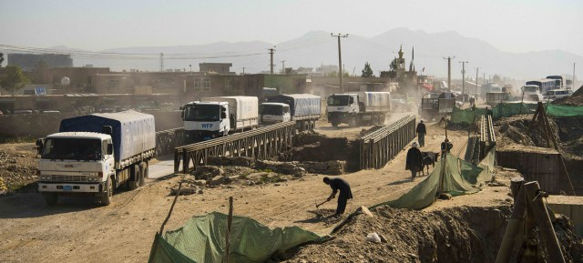 Trucks from the UN's World Food Programme leave Kabul in May 2021 to deliver food to vulnerable communities.