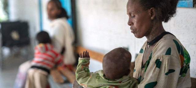 A mother holds her one-year-old son, who is suffering from malnutrition, at a health centre in the Tigray region of northern Ethiopia.