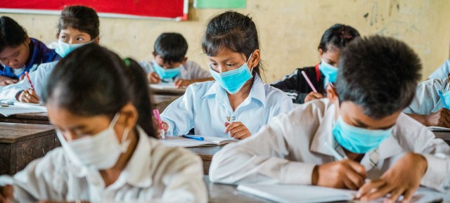 Students at a school in Cambodia are studying despite the COVID-19 pandemic.