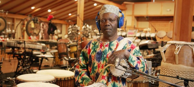 """Nigerian percussionist Sikiru Adepoju performing """"King Clavé"""", a collaboration between Playing For Change and Planet Drum."""