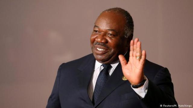 Gabon's President Ali Bongo waves his hand in greeting