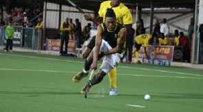 Alfred Ntiamoah tackles his opponent from behind during their match against South Africa