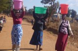 Pictures Of Melinda Gates, Wife Of World's Richest Man Carrying Water On Her Head In Malawi