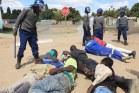 WATCH: Zimbabwe traffic cops assault man at roadside in full view of motorists
