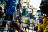 Political will, financial support needed to bolster new approach to cholera in Haiti