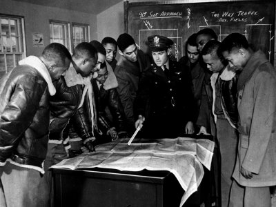 members-of-the-famed-tuskegee-airmen-looking-at-a-flight-map-during-a-training-class