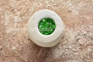 Broken glass in clay mould