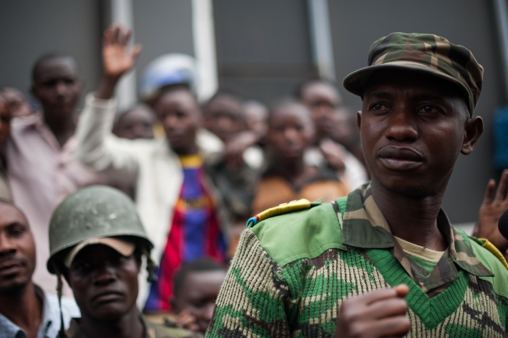 Colonel Mamadou Ndala, commander of the 42nd  battallion of the Congolese armed forces (FARDC), addresses a crowd as he tries to disperse a demonstration in Goma in the east of DR Congo on August 2, 2013. Several hundred angry civilians stoned UN vehicles and called for the UN to leave the country, due to a perceived feeling of inaction by UN forces. Col. Mamadou has gained a large following of civilians in eastern DRC with recent successes over M23. [PHIL MOORE]