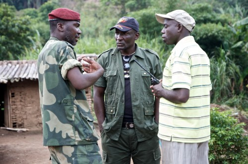 The APCLS senior officers mid-discussion at their military base in Lukweti. From left to right: 'Colonel' Jeff, the Movement's Secretary General, 'Colonel' James, second in command, head of Operations and Communications and 'Colonel' Elie, second in command, head of Administration and Logistics. Masisi territory, August 2013. ALEXIS BOUVY/Local Voices
