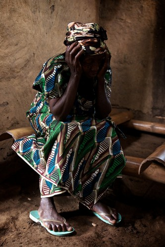 In Lukweti, an elderly lady prays in church during Mass on Sunday. Lukweti, August 2013. ALEXIS BOUVY/ Local Voices