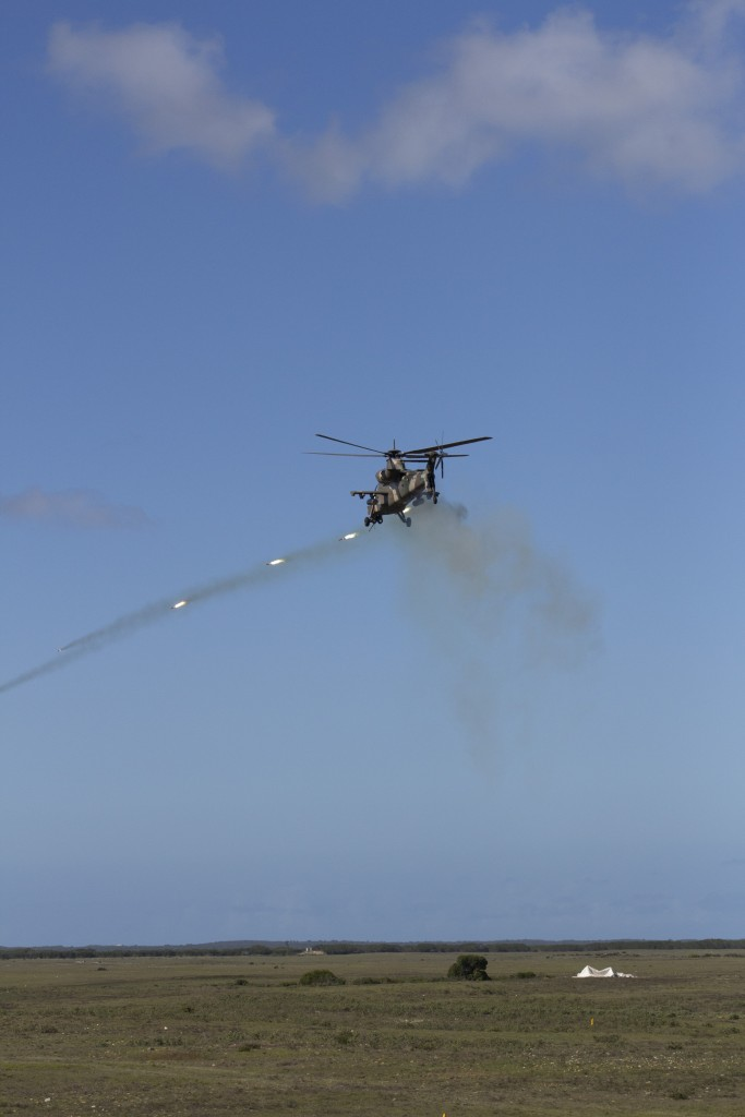 Rheinmetall Denel Defence Day - A Rooivalk attack helicopter fires a ripple of 70mm FFAR rockets. ADR/JOHN STUPART