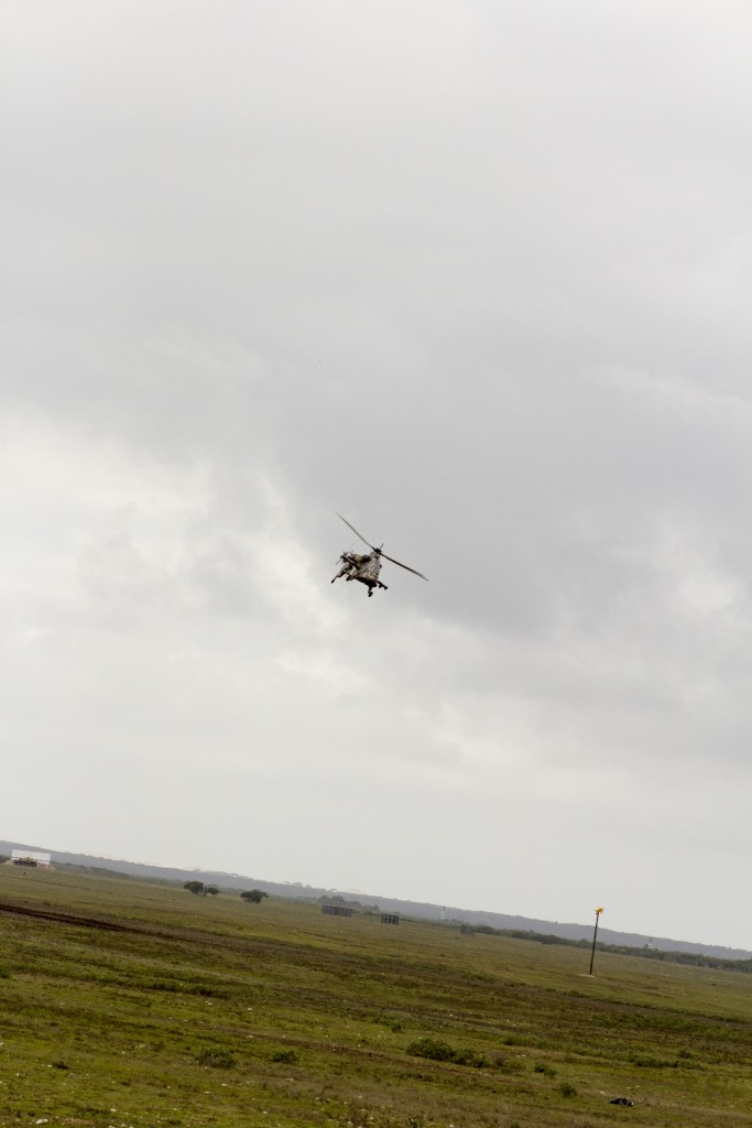 Rheinmetall Denel Defence Day - A SAAF Rooivalk Attack Helicopter banks during its weapons run.