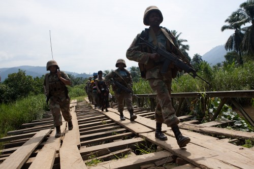 he South African peacekeepers of the MONUSCO Force Intervention Brigade patrol the town of Pinga as part of a mission to secure the area. Photo MONUSCO / Marie Frechon