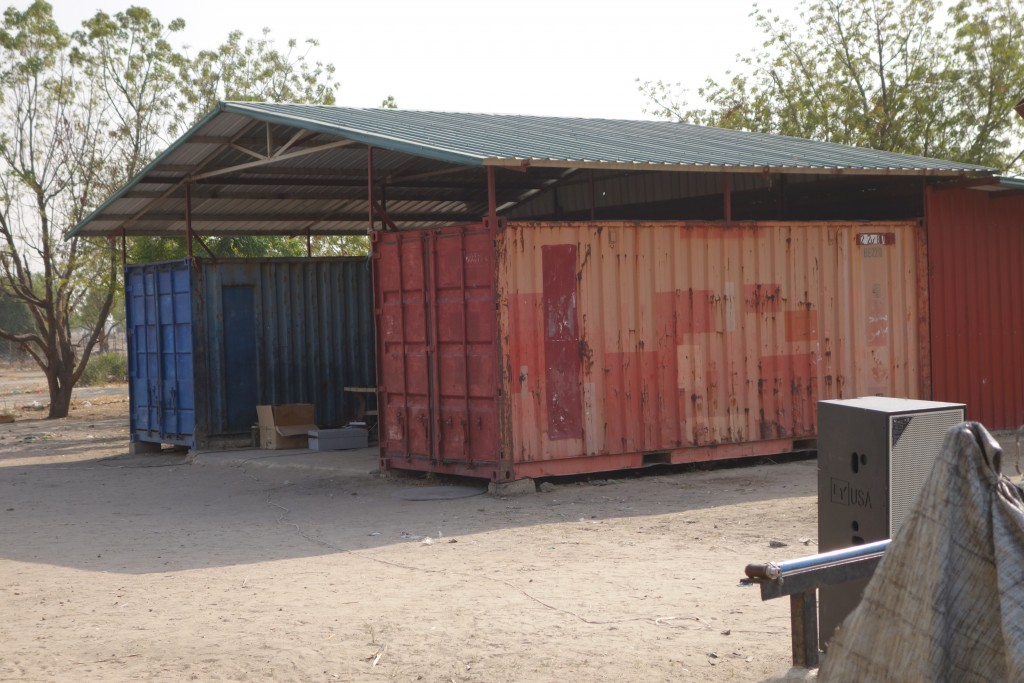 The red container (left) suspected by Amnesty International to have been used to hold and suffocate as many as 59 prisoners by the SPLA. Image courtesy of Amnesty International.