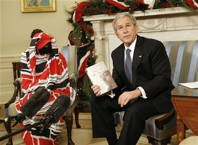 Dr Halima Bashir with the previous president of USA George W. Bush, White house