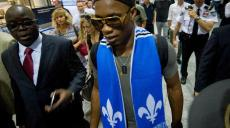 MONTREAL, QUE.: WEDNESDAY, JULY 29, 2015 -- Didier Drogba is escorted through Pierre Trudeau Airport in Montreal, Quebec, on July 29, 2015. Drogba arrived from London England and was greeted by hundreds of chanting fans. (Frederic Hore / MONTREAL GAZETTE)