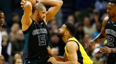 Feb 2, 2018; Charlotte, NC, USA; Charlotte Hornets guard Nicolas Batum (5) holds the ball while Indiana Pacers guard Cory Joseph (6) defends in the first half at Spectrum Center. Mandatory Credit: Jeremy Brevard-USA TODAY Sports