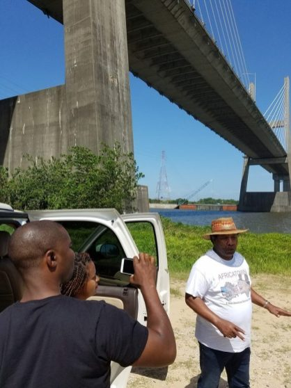 Garrett shoots video with Womack during their tour under the Africatown Bridge that crosses the Mobile River