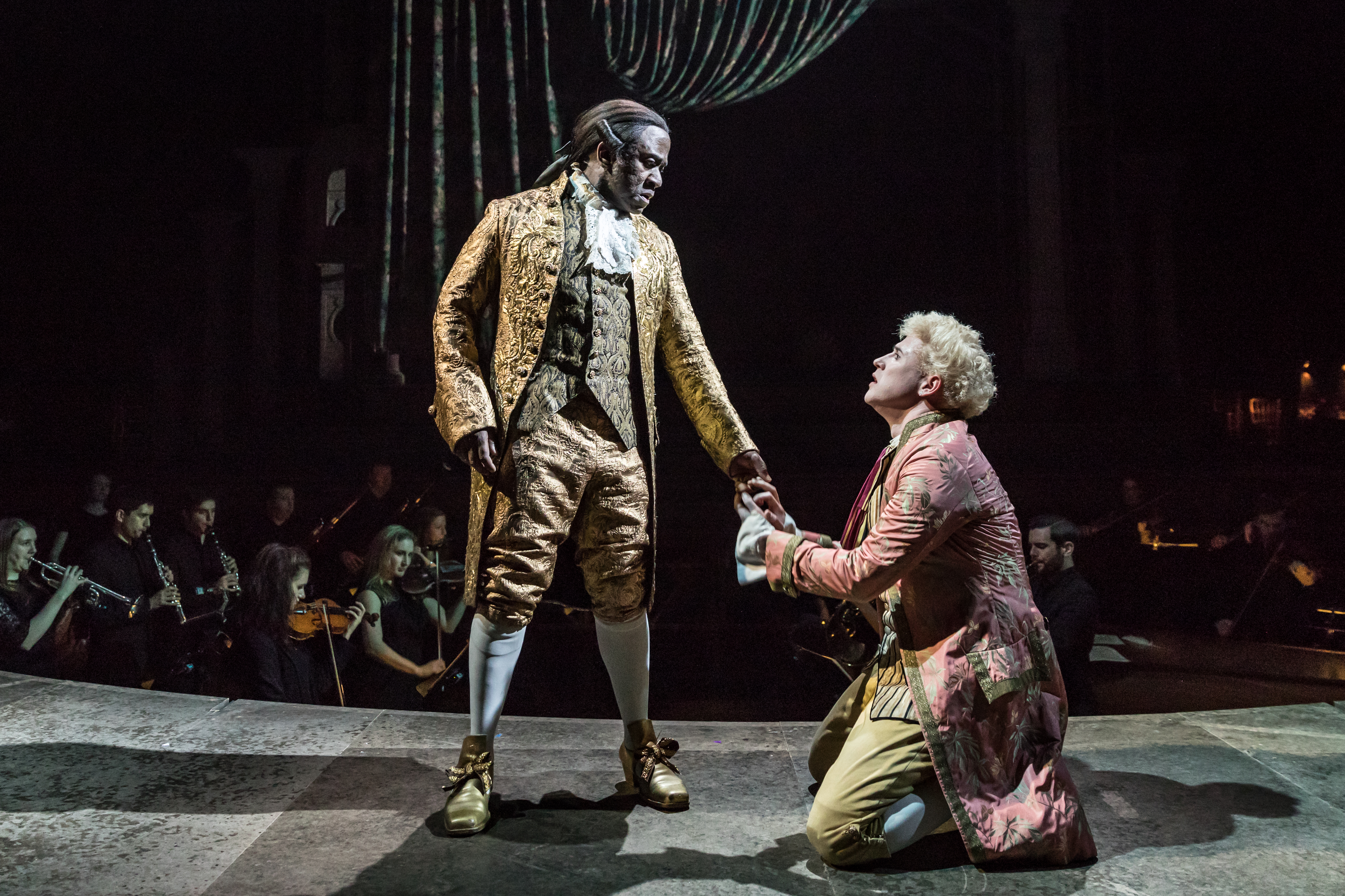 Lucian Msamati as Antonio Salieri and Adam Gillen as Wolfgang Mozart in Amadeus at the National Theatre (c) Marc Brenner