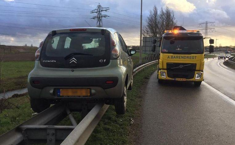 Photo of Oops! Motorist 'parks' perfectly on the barrier of highway