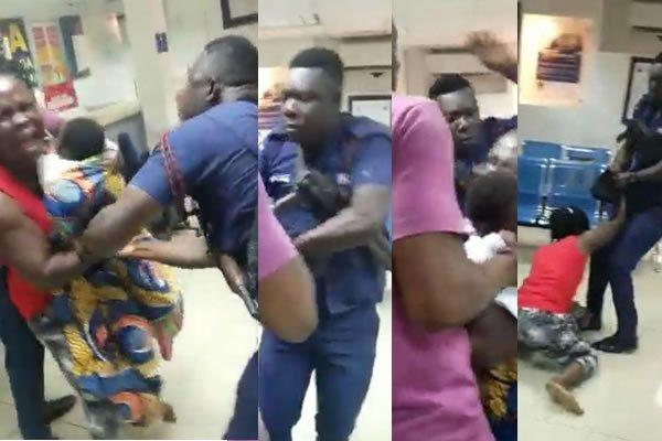 A policeman beats a woman carrying a baby in a bank (VIDEO)